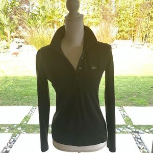 This a soft black polo shirt from Lacoste